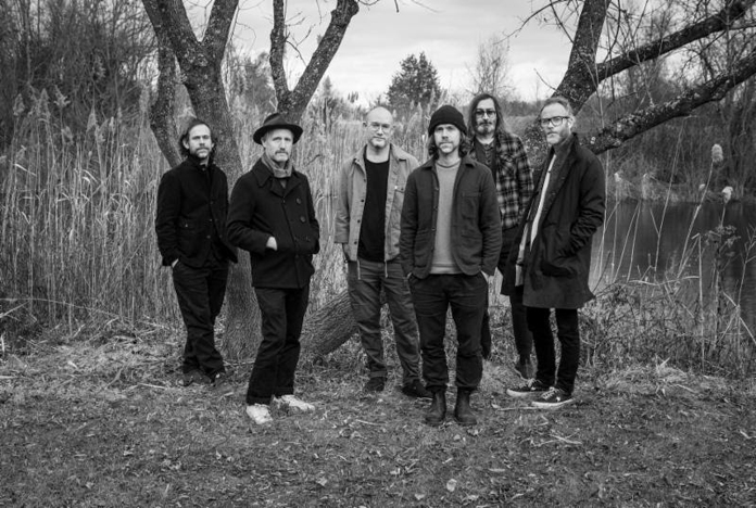 6 band members of the national press photo near a tree