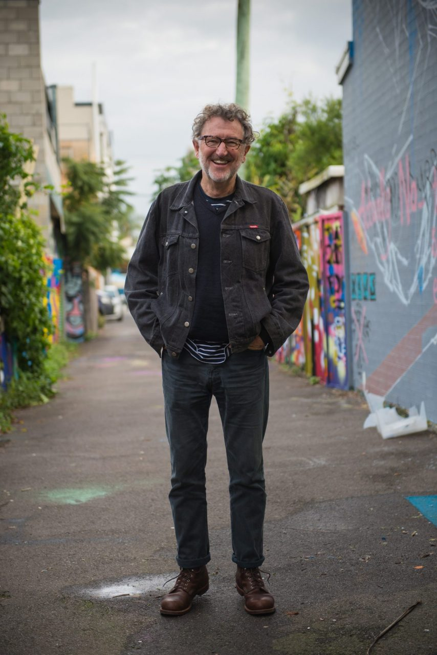 picture of Ben steer in an alley with graffiti
