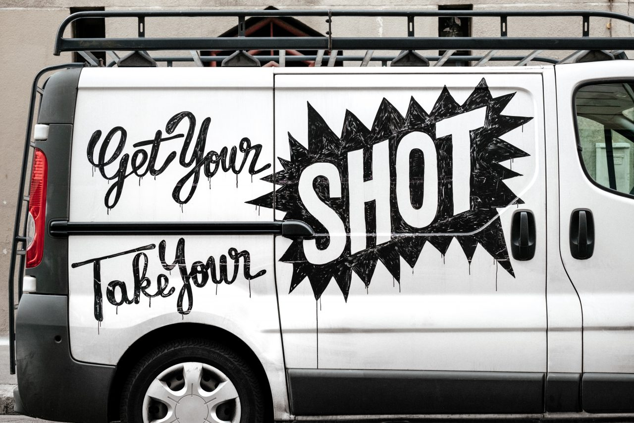 White Van With Black Writing Get Your Shot Take Your Shot