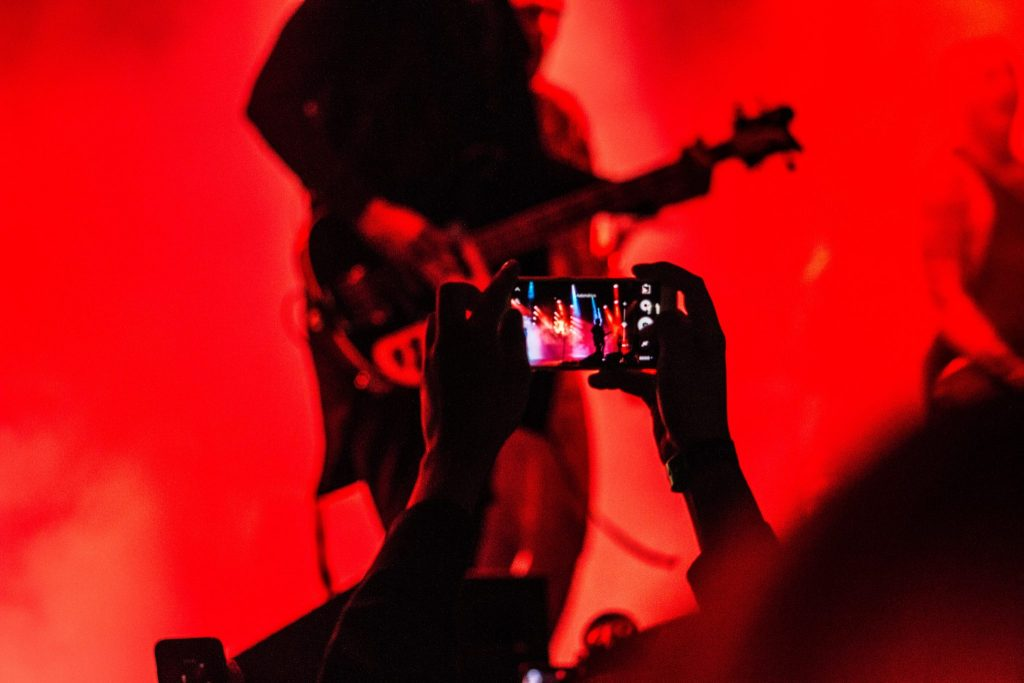 person taking a photo picture with a red hue